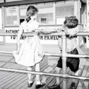 Boy and Girl on a Boardwalk